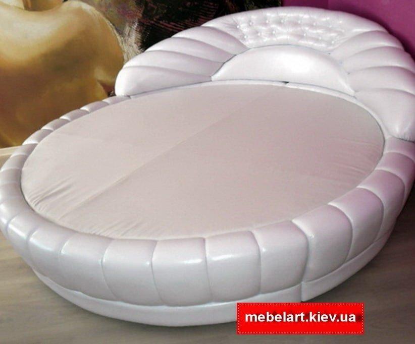 круглая кровать в виде ракушки